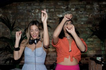 Laura Pradelska and Lara Fraser kick off the Grooming Room rooftop launch party behind the decks by Maria Nicolas